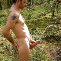 man pissing naked with eection