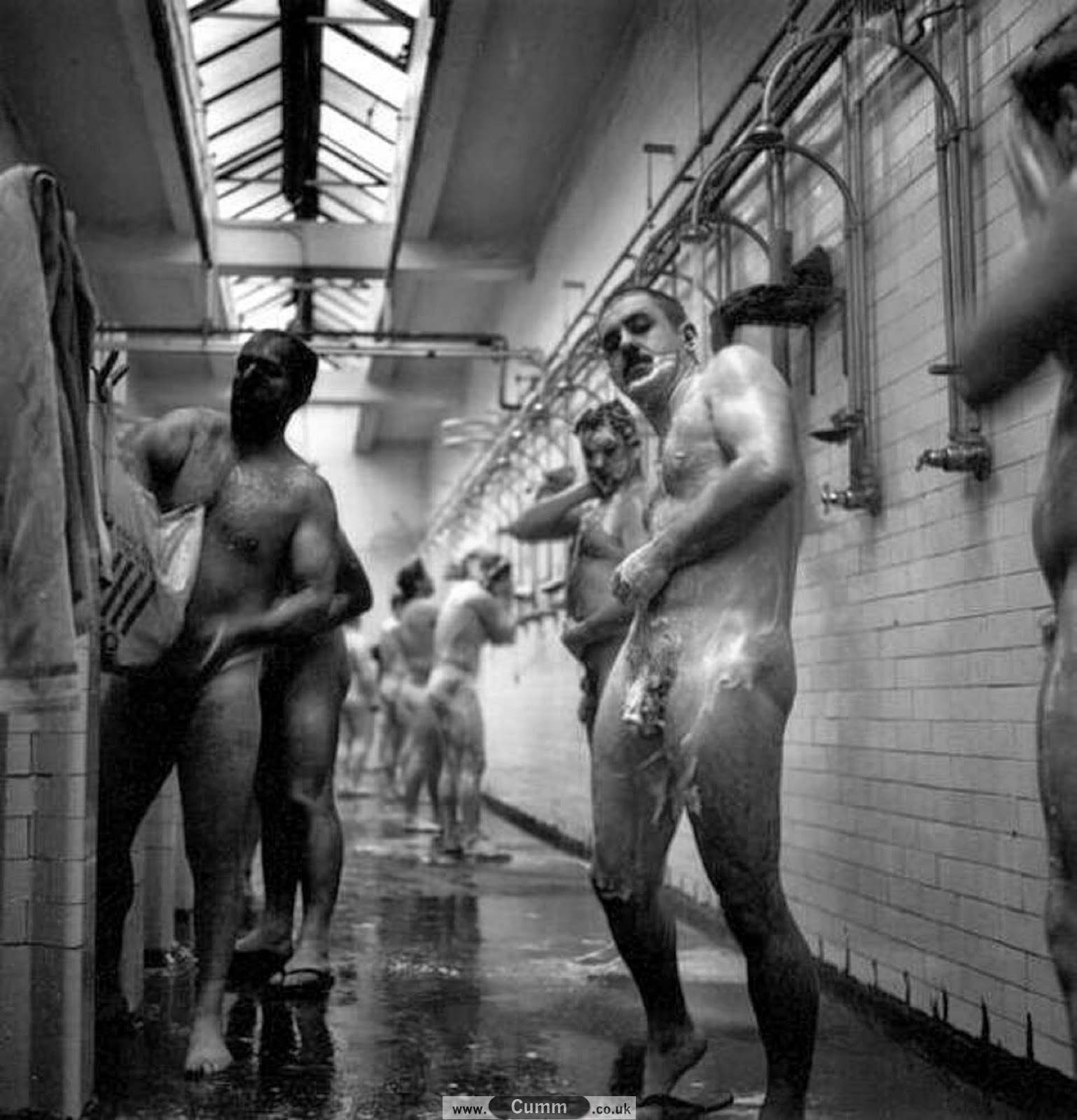 Communal showers full of bare naked guys