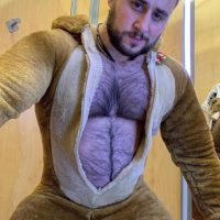 straight gay or bisexual or just a sexy hairy chested young man in a onesie