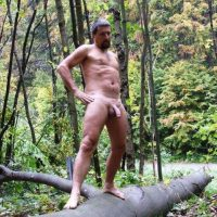 lad nude in forest shows his godly penis