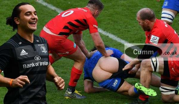 NEWCASTLE UPON TYNE, ENGLAND - MAY 11: James Lowe of Leinster has his shorts pulled down in a tackle from Schalk Burger of Saracens during the Champions Cup Final match between Saracens and Leinster at St. James Park on May 11, 2019 in Newcastle upon Tyne, United Kingdom. (Photo by Dan Mullan/Getty Images)