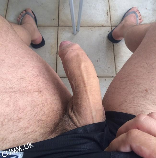 lowered-penis-juicy-balls sexy dude takes photo of his lowered sexy fat penis with hairy balls its very sexy indeed